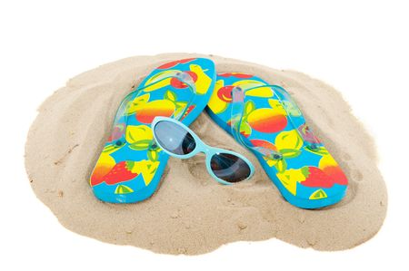 freetime: beach vacation with sandals and sunglasses in concept