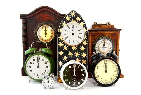 Twelve OClock with many clocks at new years eve  photo