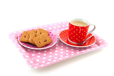 speckles: Speckles crockery with coffee and a plate with cookies Stock Photo