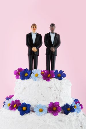 homo: Wedding cake with flowers  and homo couple on top