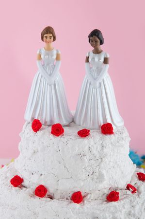 black lesbian: Lesbian wedding couple on top of the cake