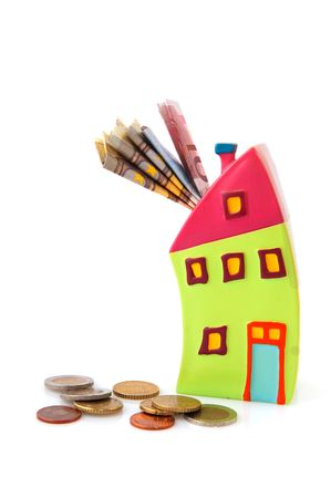 Saving money for the house in piggy bank photo