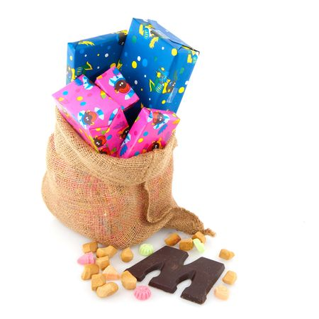 Presents and candy in the bag from Dutch Sinterklaas photo