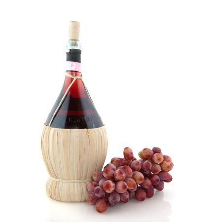 Basket bottle with Chianty and grapes from Italy over white