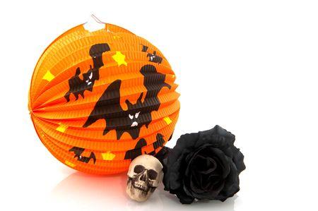 grisly: Orange Halloween lantern with bats black rose and skull
