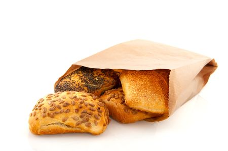 Luxury bread rolls in bag with grain isolated over white photo