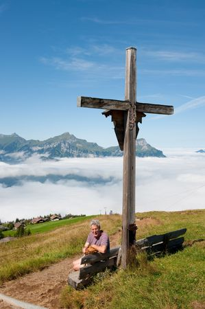 In the mountains from Switzerland above the clouds photo