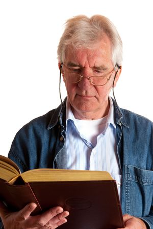 Portrait of a reading elderly man in studio Stock Photo - 5740559