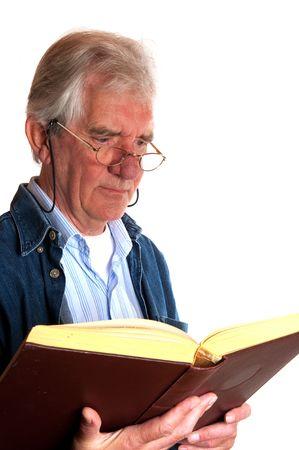 Portrait of a reading elderly man in studio Stock Photo - 5740548