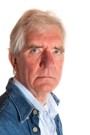Portrait of a angry elderly man in studio Stock Photo - 5740541