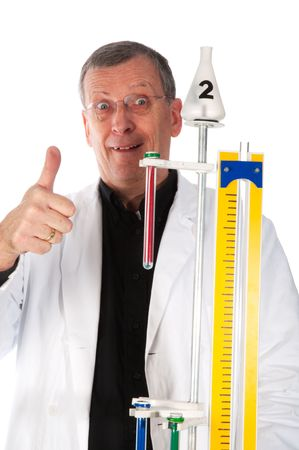 dangerous experiment with liquids and testtubes in the laboratory by a nutty professor photo