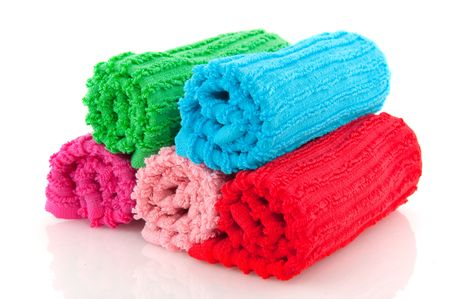 colorful rolled towels from terry isolated over white photo