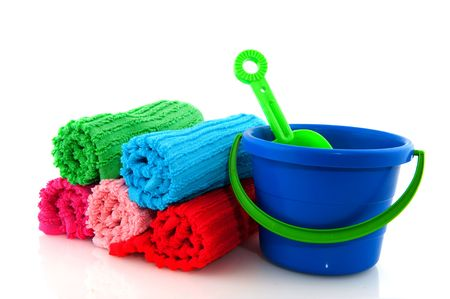 colorful rolled towels from terry and play set for the beach isolated over white photo
