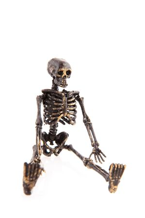 grisly: Sitting skeleton for Halloween isolated over white