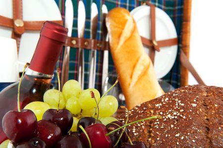 Good filled picnic basket with fresh fruit and bread photo