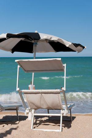 recanati: empty sunbeds ready for a good beach vacation