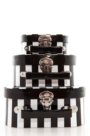 whote: stacked suitcases in black and white for vacation