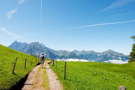 walking in the mountains from Switzerland above the clouds photo