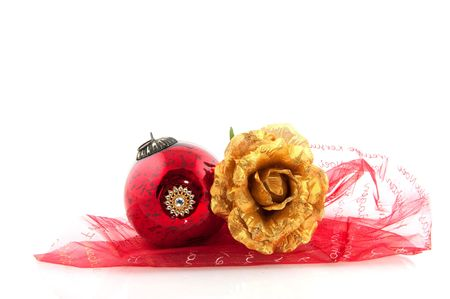 Antique christmas ball and golden rose with white background photo