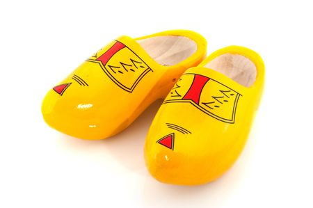 Yellow wooden shoes from Holland isolated over white photo