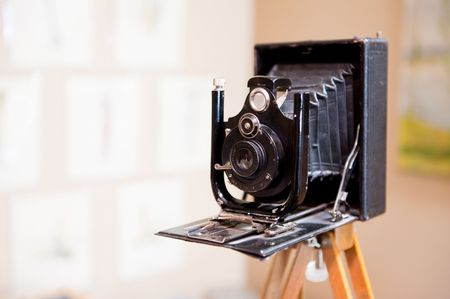 antique photo camera with bellows on a statif Stock Photo - 5878598