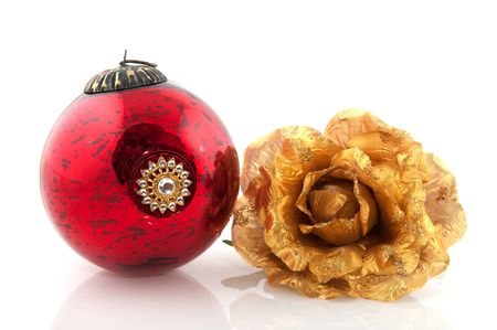Antique christmas balls and golden rose with white background photo