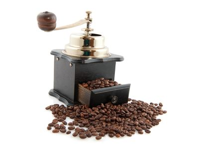 Old fashioned coffee grinder to crunch the beans photo