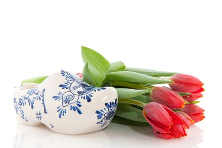 Dutch national products with clogs and tulips photo