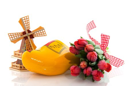 Dutch national products with clogs windmill and tulips photo