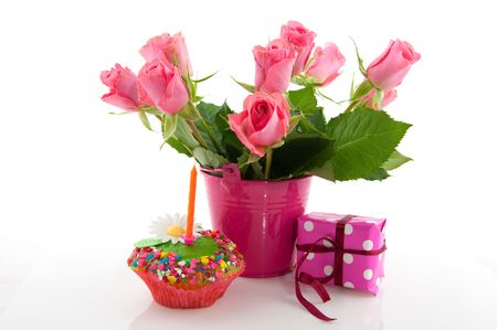 still life flowers: Birthday with roses fancy cake and present Stock Photo