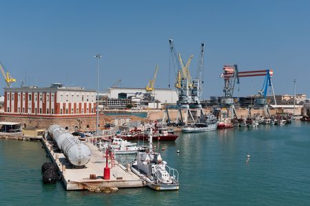 Big industrial harbor with many cranes and ships Stock Photo - 5919791