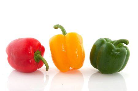 mixed vegetables: Three ripe paprikas in red green and yellow Stock Photo