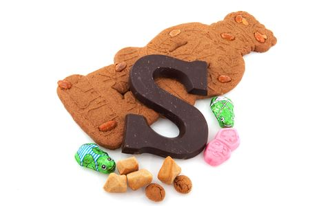 speculaas: Speculaas doll and other candy for Dutch Sinterklaas isolated over white