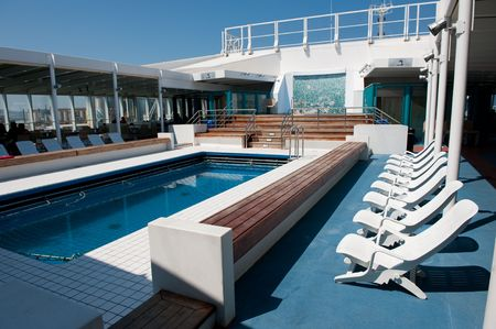Swimming pool at the cruis ship in the sun Stock Photo