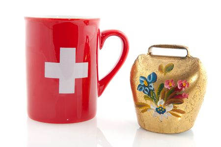 Switzerland with red mug and cow bell with flowers photo
