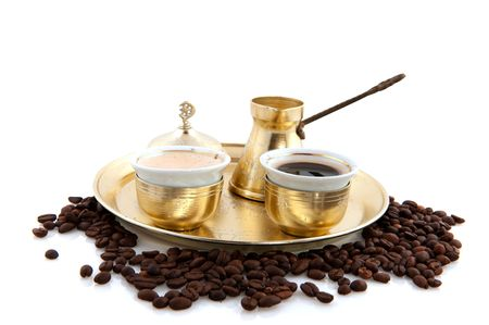 Turkish coffee in traditional crockery with bean and white background photo