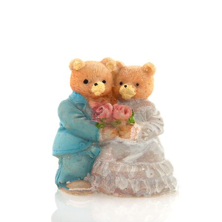 couple bears f a wedding day with bride and groom photo