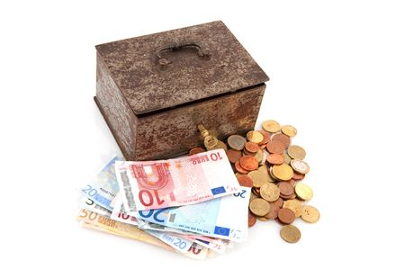 old,rusty money box with Euros isolated over white photo