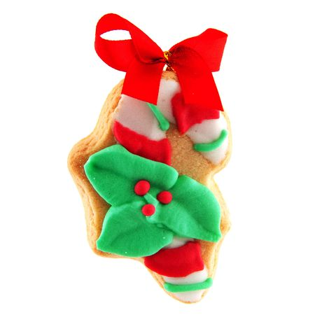 ginger bread cookiechristmas cane and leaves with red bow photo