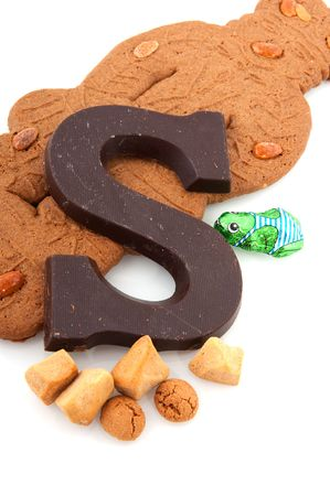 Speculaas doll and other candy for Dutch Sinterklaas isolated over white Stock Photo - 5980274