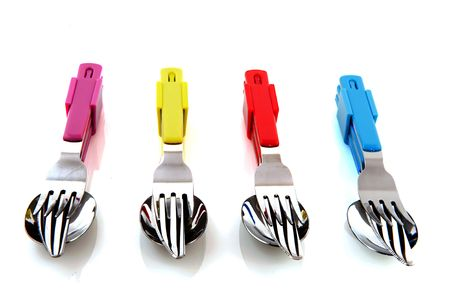 colorful forks knifes and spoons with white background photo