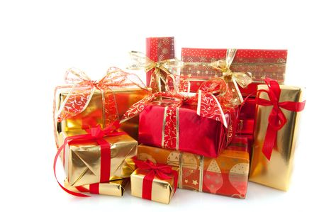 glancing: Many luxury christmas presents in red and gold Stock Photo