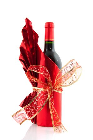 glancing: Bottle wine in red glancing paper and luxury ribbon Stock Photo