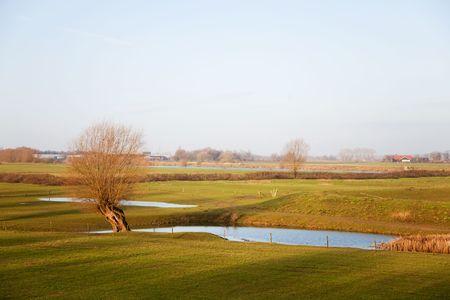 River landscape in Holland at the Gelderse IJssel photo