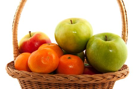 Basket filled with red and green apples and tangerines photo