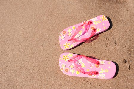 summer vacation at the beach with flip flops in the water Stock Photo - 6087190