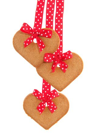 speckles: Baked gingerbread hearts with red speckles bows and ribbon