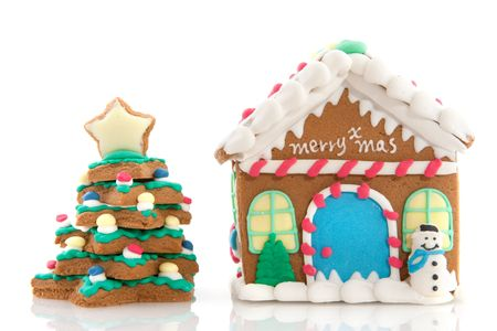Cheerful gingerbread house on a pink background Stock Photo - 6087246