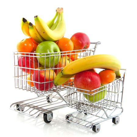 Shopping cart from the supermarket filled with fresh fruit photo
