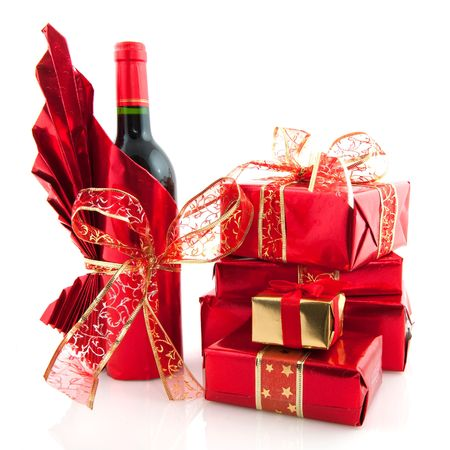 Luxury christmas presents and wine wrapped in red